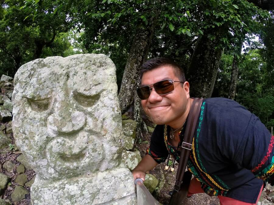 Happy statues at Copan, Honduras