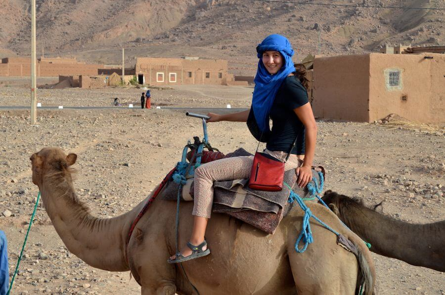 Riding camels at Zagora