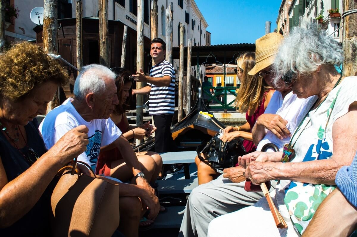 Shared gondola ride at Venice, Italy